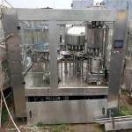 出售二手碳酸飲料三合一灌裝機-三合一全自動沖洗罐裝封口機